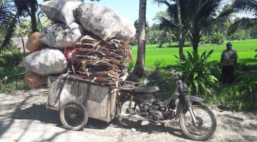 Indonesian Waste Recycling Trader Motorbike